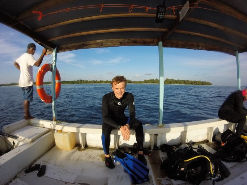 Buoy 2-Last dive complete, a big grin and a not so big island in the background.