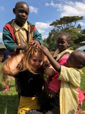 Nursery school children playing hairdresser