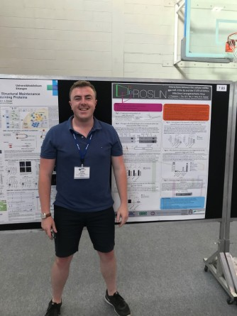 Myself standing by my poster during the conference