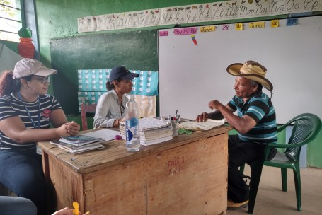 One of the in country lawyers and translators consulting with a client during one of the legal clinics