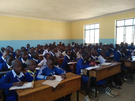 Secondary school students taking notes during our lesson on the environment