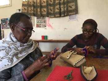 Madame Njeru and Judy learning how to crochet mats before we began teaching the children