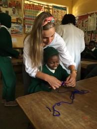 Teaching Sabastian how to crochet a mat