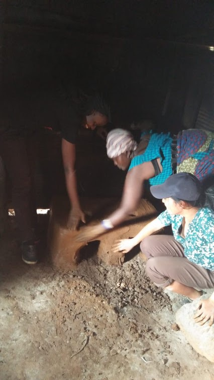 Getting our hands dirty; making energy-saving jikos (stoves) with a mixture of cow dung, ash and soil. The cow dung was as fresh as you could imagine, literally straight from the cow (no gloves were used). No carbon footprint here