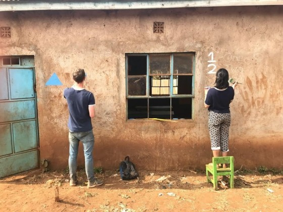 The matching T-shirts were unplanned; here we are painting a primary school with shapes and numbers