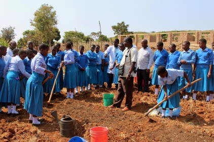 Chris, head of Envirocare, helping prepare a bare-root tree nursery at Oswe Girls Secondary School