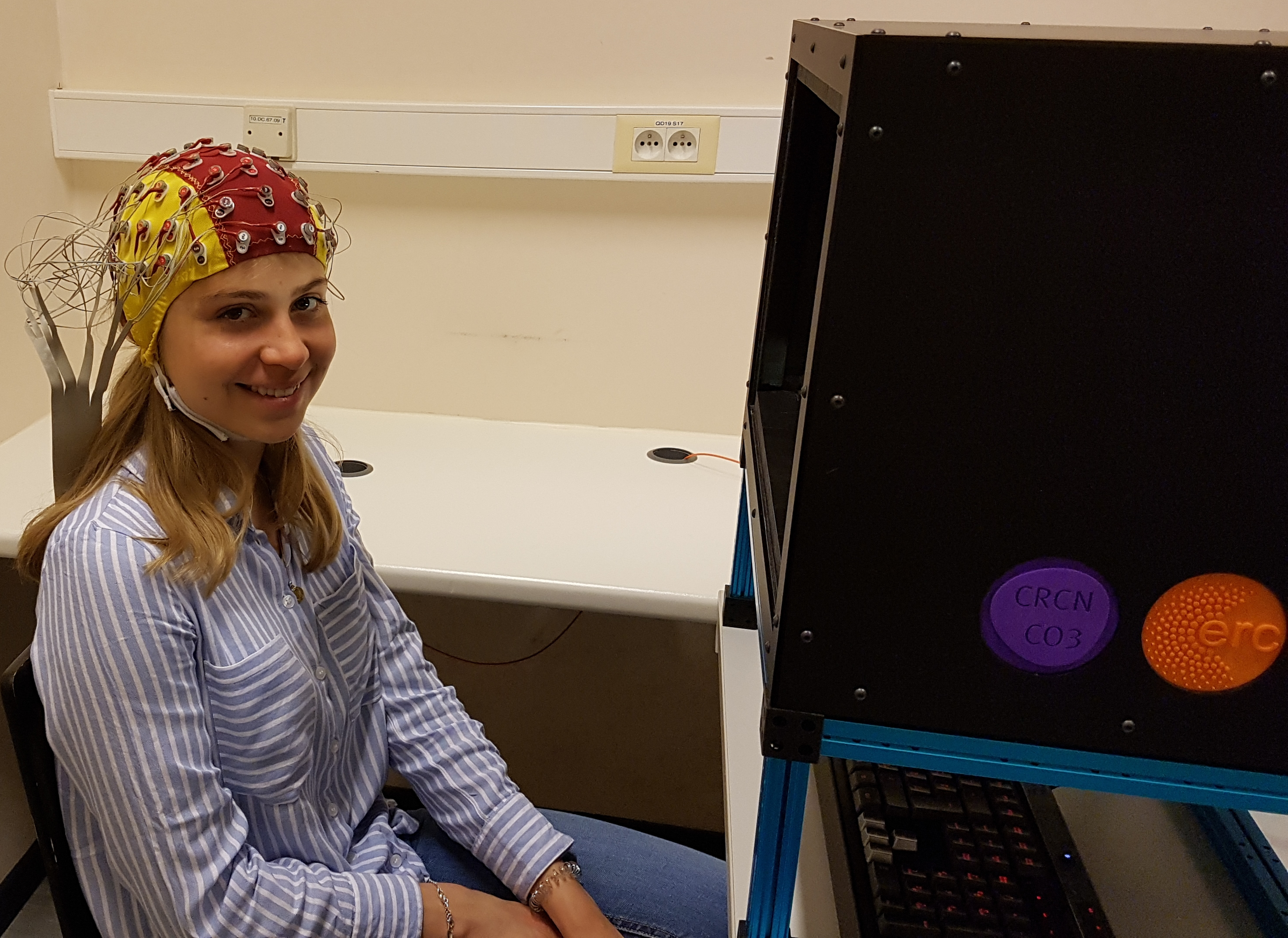 Student wearing EEG cap to measure voltage changes in the brain.